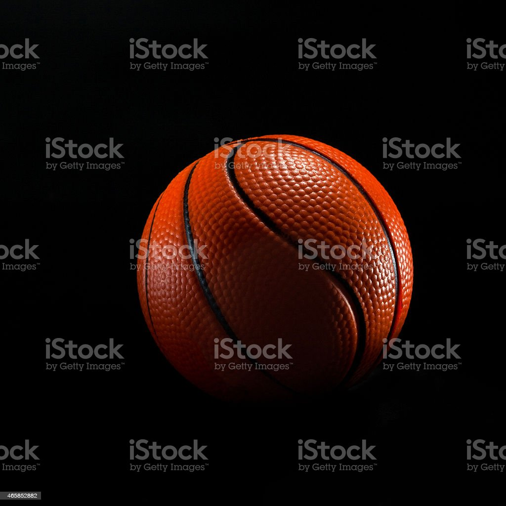 basketball ball isolated on black stock photo