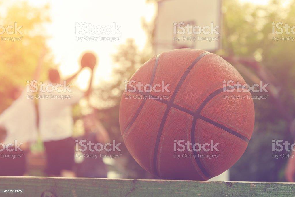 Basketball ball on a bench stock photo