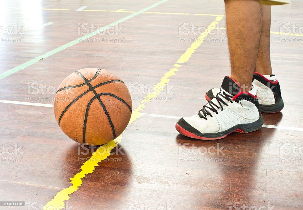 Basketball ball over floor stock photo