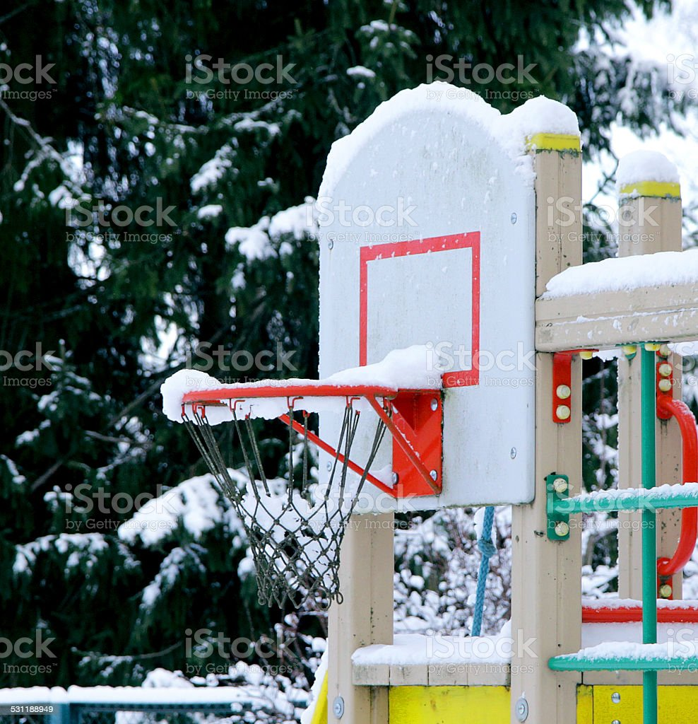 basketball basket under snow stock photo