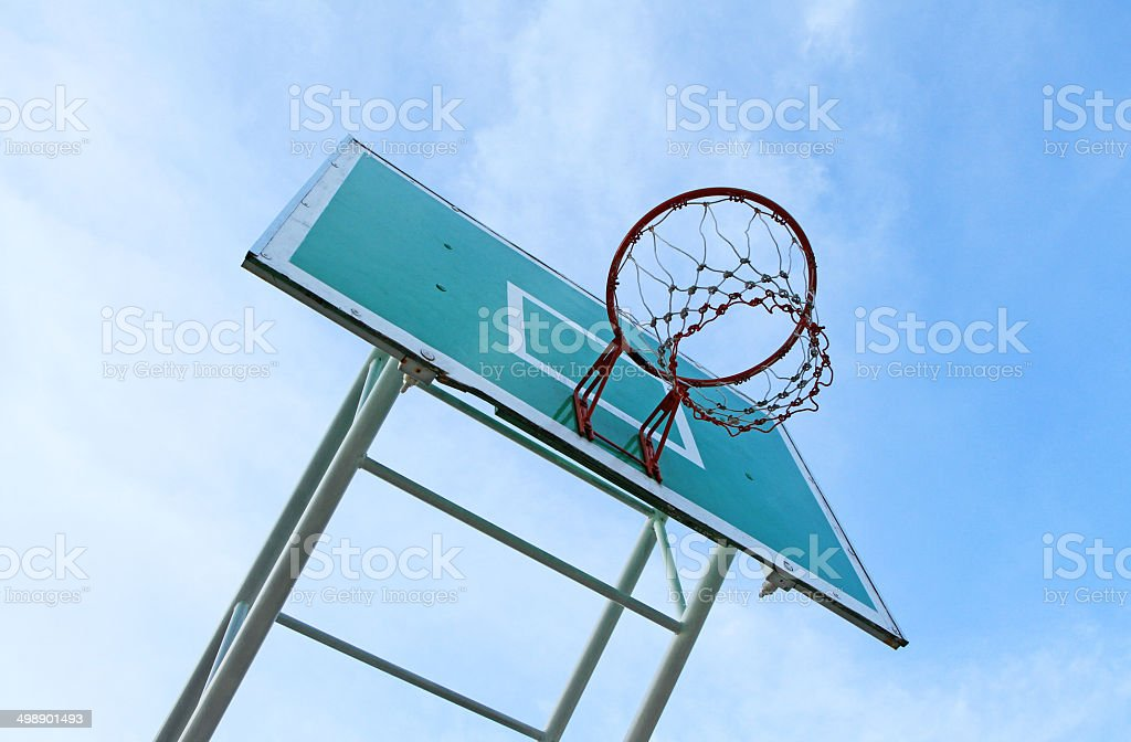 Basketball board against blue sky background stock photo