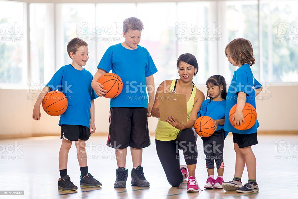 Basketball Coach Showing the Kids a Play stock photo