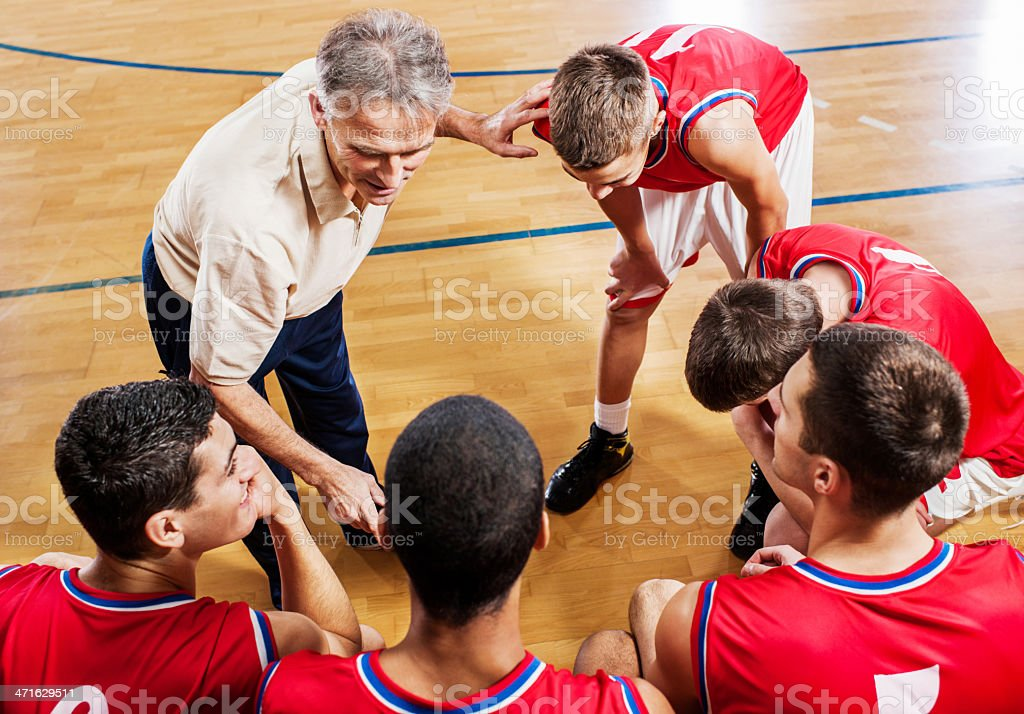 Basketball coach with his team. royalty-free stock photo
