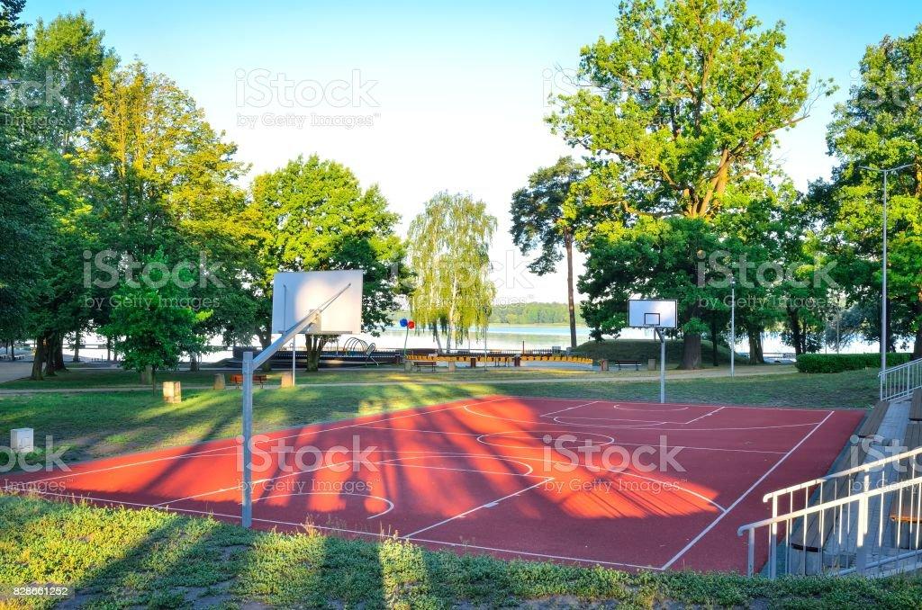 Basketball court over the lake. stock photo