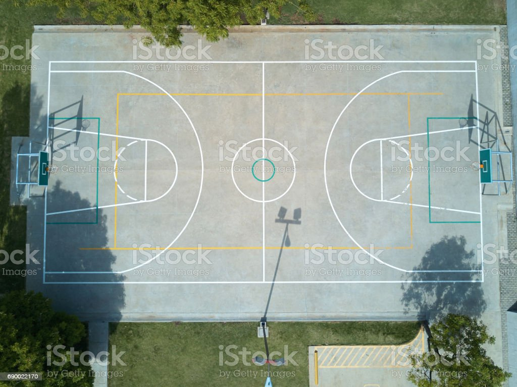 Basketball field aerial view on day time. Sport court above view from...