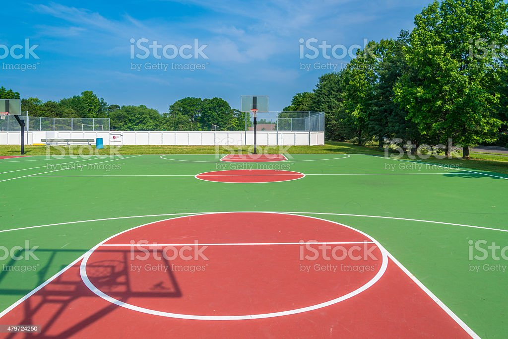 Outdoor basketball field at sunny day