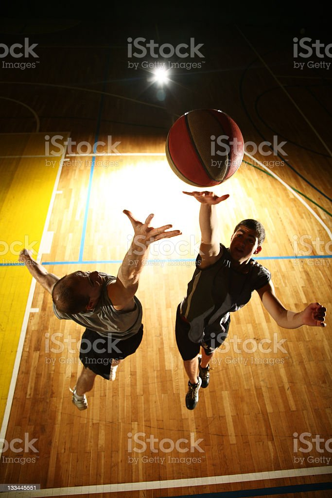 Basketball fight - dark silhouettes stock photo