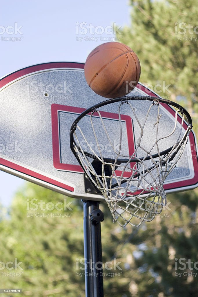 Basketball flying towards a basket royalty-free stock photo
