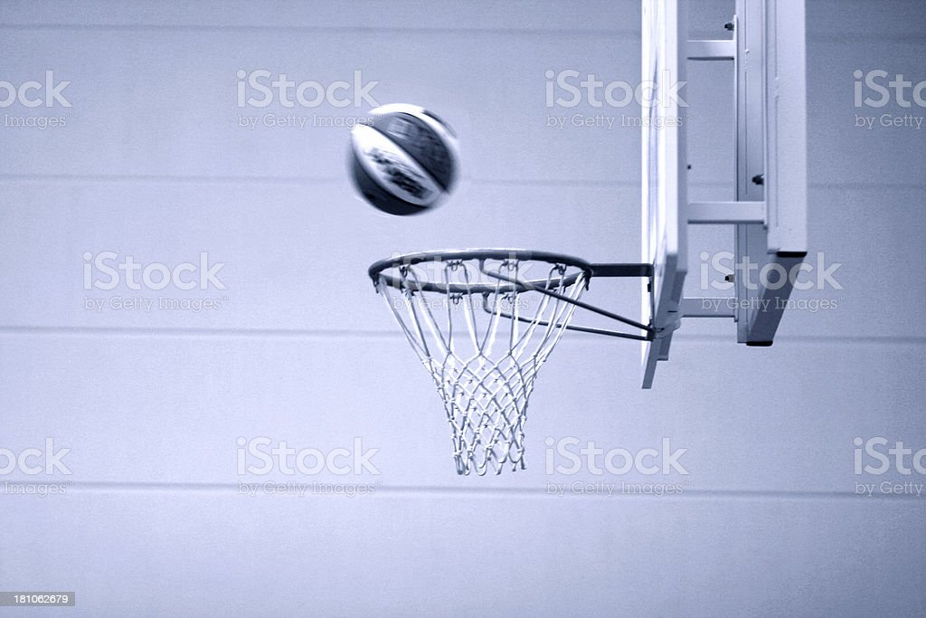 Basketball going through the hoop.