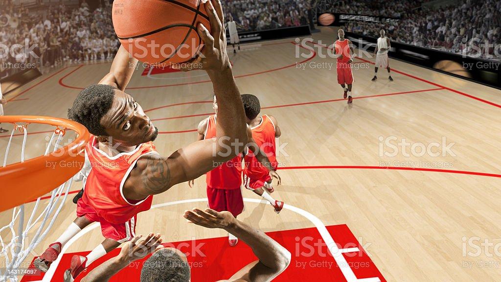 Basketball Hero Does Reverse Slam Dunk royalty-free stock photo