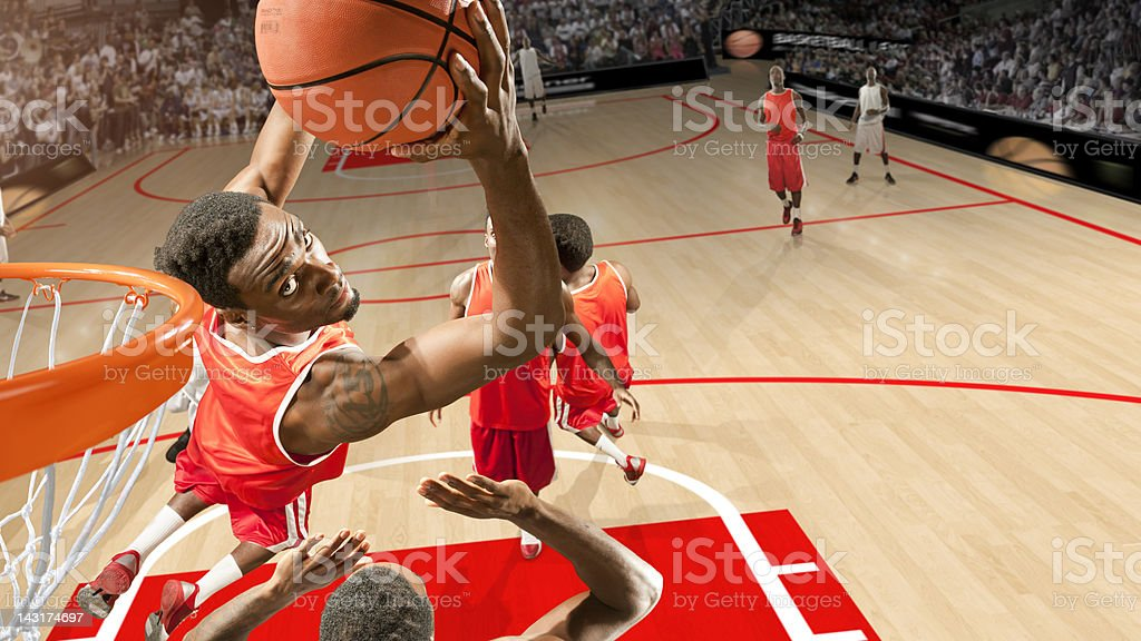 Basketball Hero Does Reverse Slam Dunk stock photo