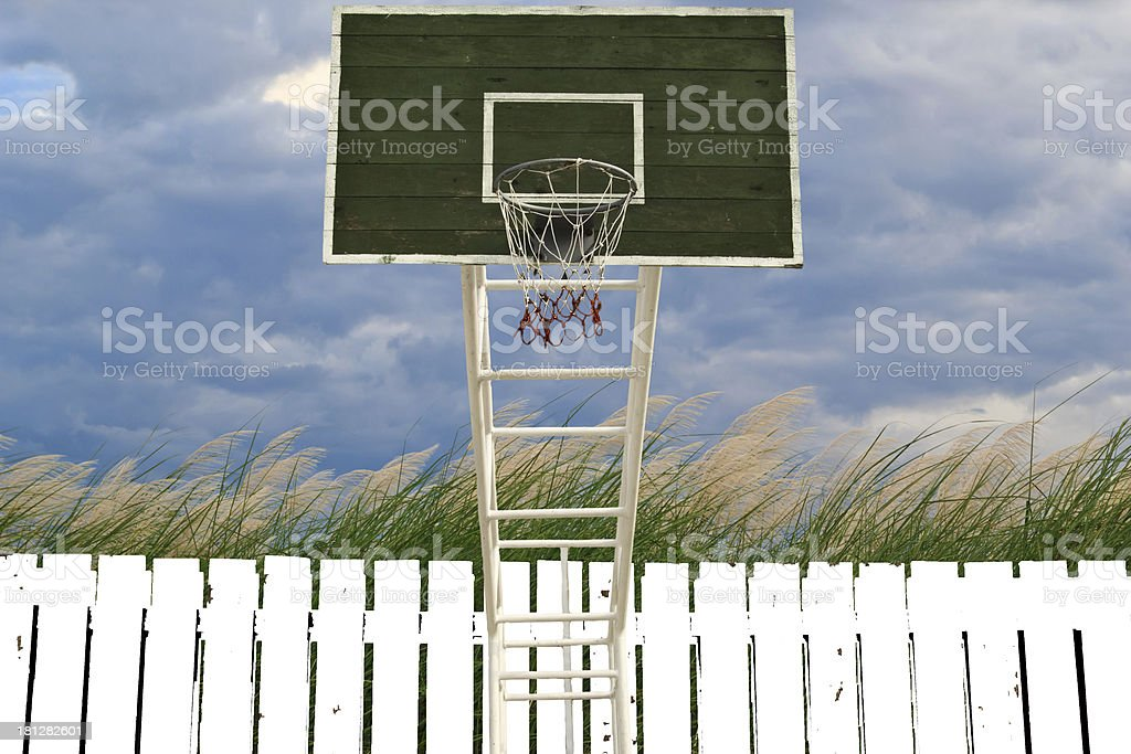 Basketball hoop .grass and cloudy sky royalty-free stock photo