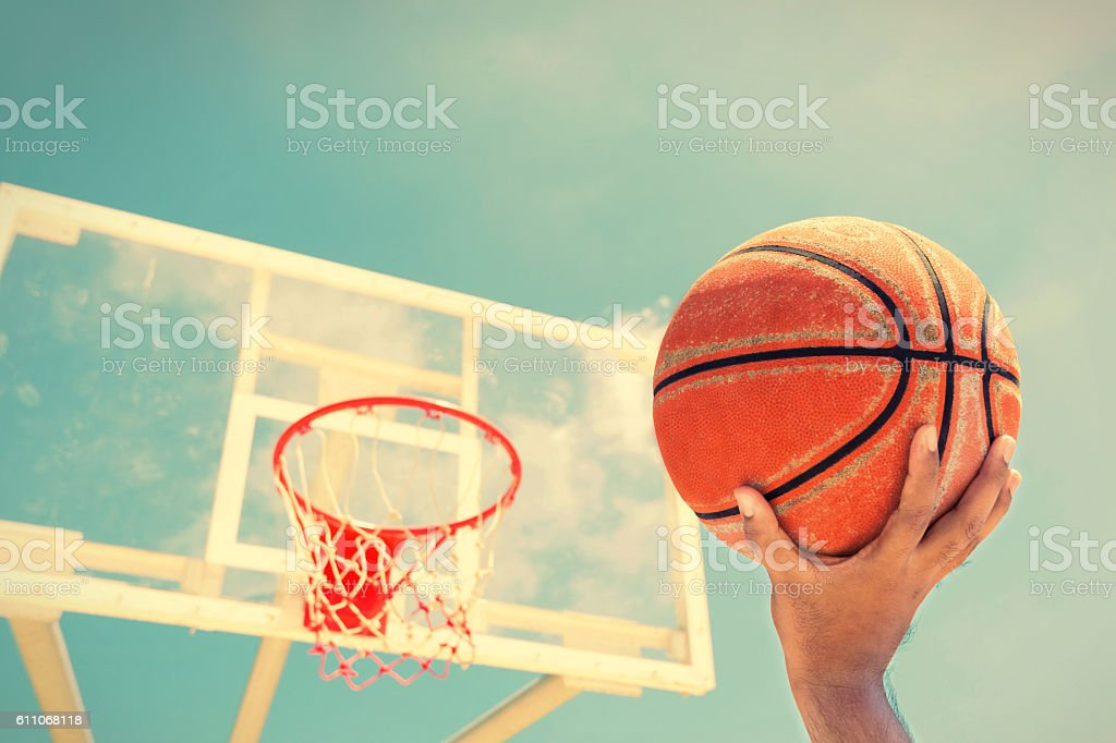 Basketball hoop on a blue sky,color filter stock photo