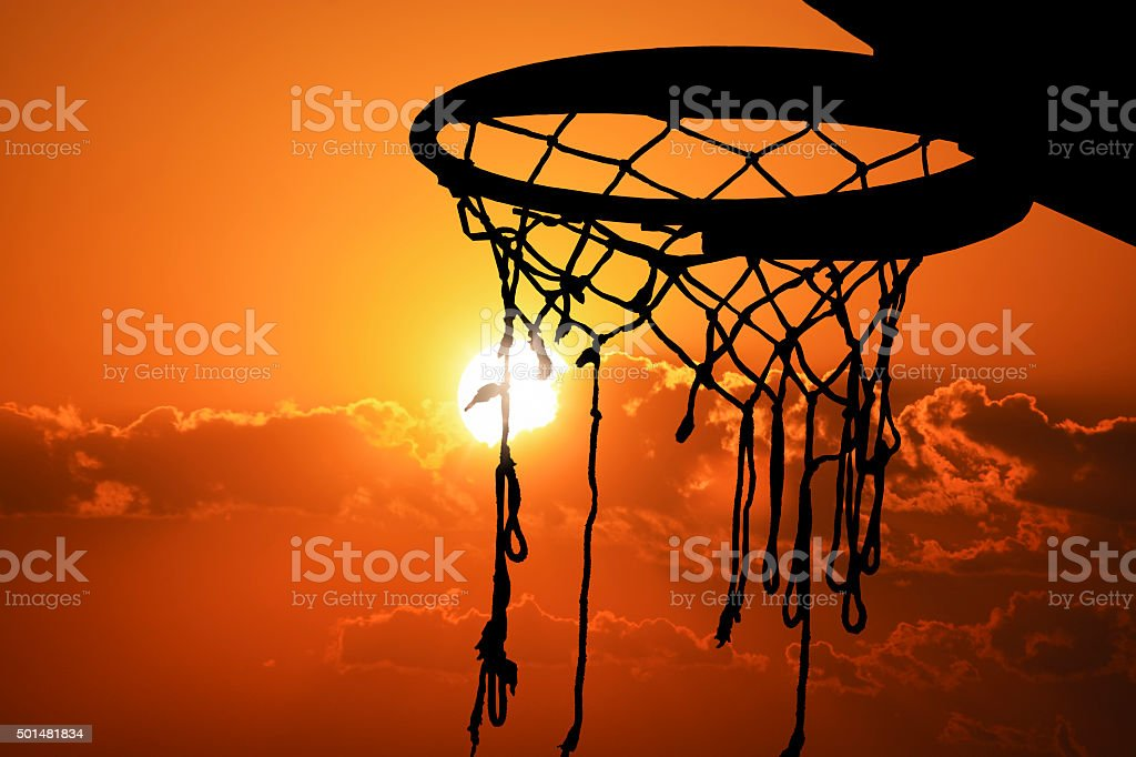 Basketball hoop outdoor in the sunset silhouette stock photo