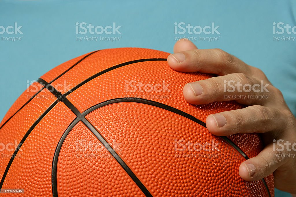 Basketball in hands royalty-free stock photo