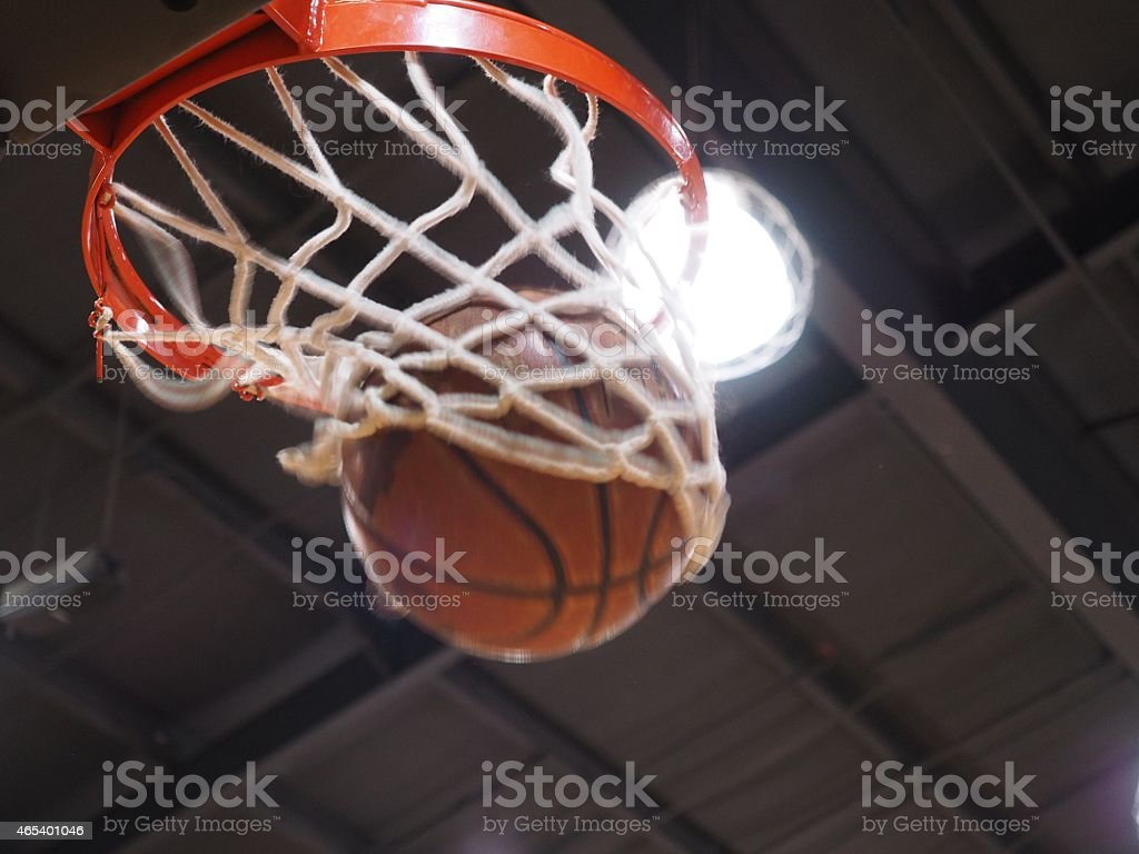 Basketball In Hoop stock photo