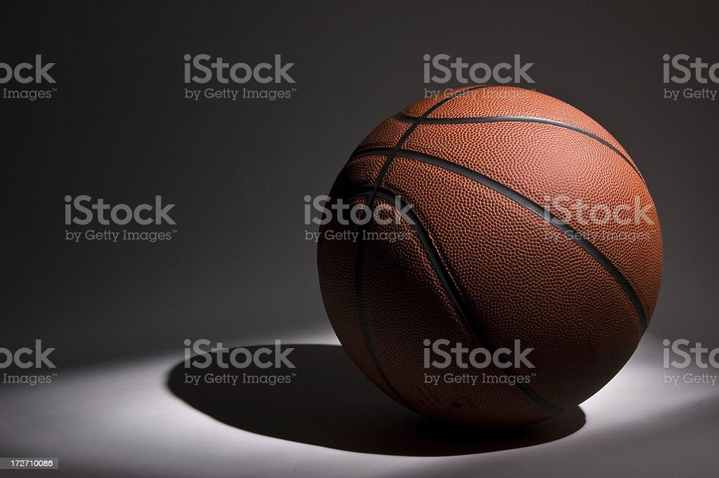 Basketball in Spotlight royalty-free stock photo