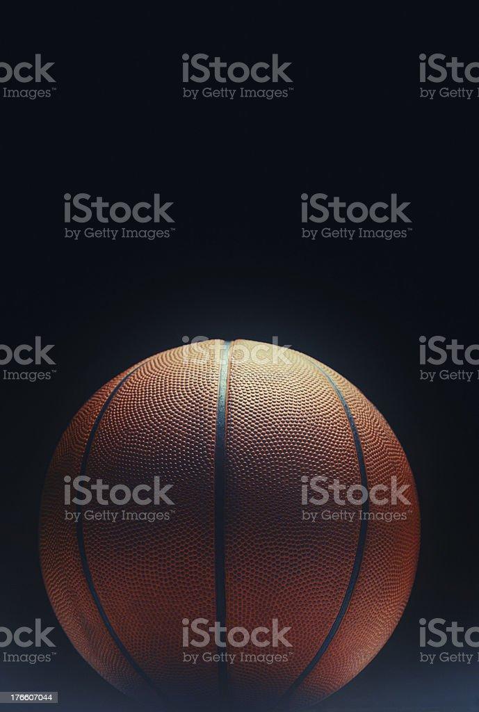 basketball in spotlight stock photo