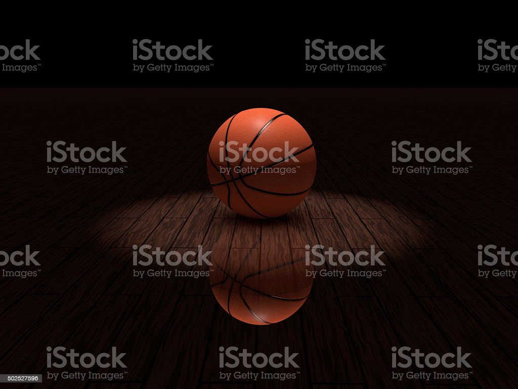 Basketball in spotlight stock photo