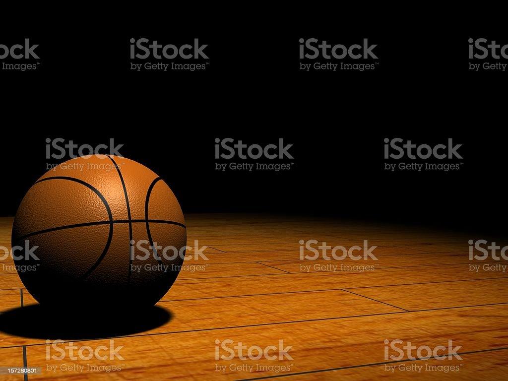 Basketball in the Spotlight stock photo