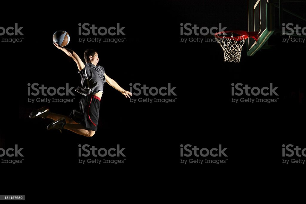 Basketball jump  dunk - isolated on black background stock photo