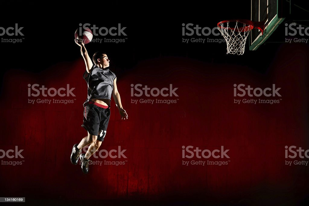 Basketball jump - isolated on red background stock photo