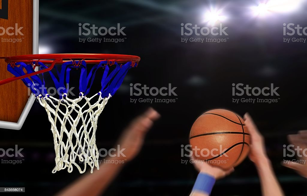 Basketball jump shot to the hoop by player stock photo