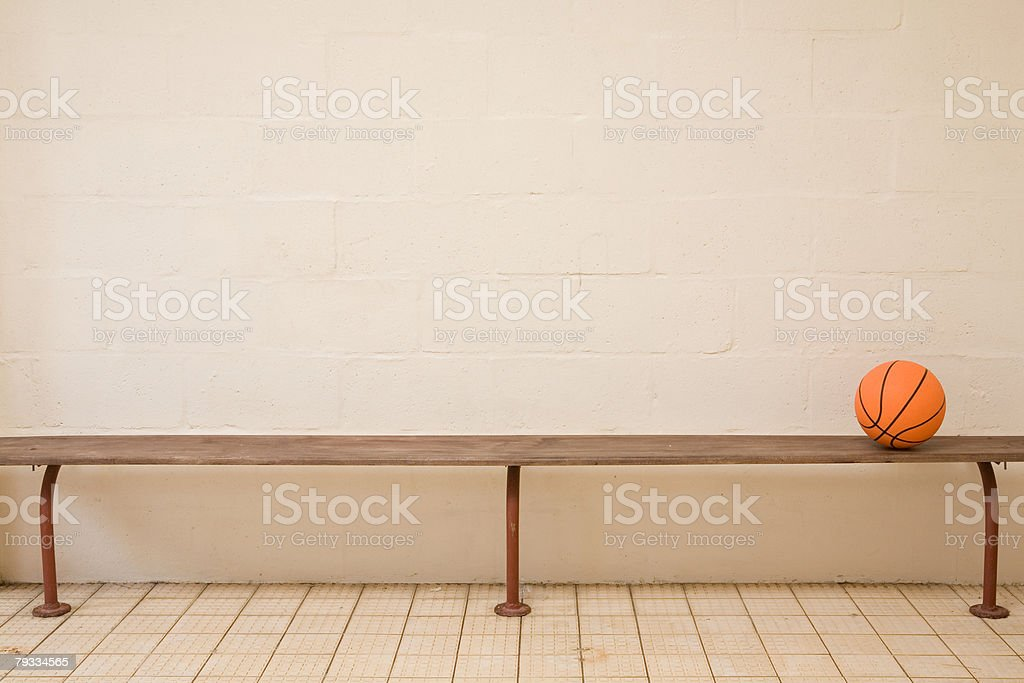 A basketball on a bench stock photo