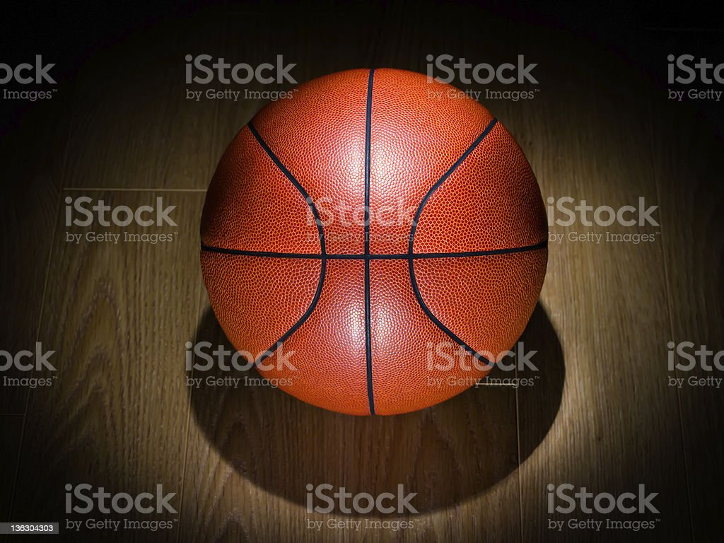 Basketball on a Gym Floor royalty-free stock photo