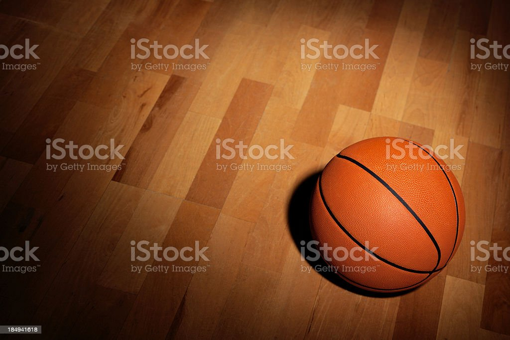 Basketball on a Wood Court royalty-free stock photo