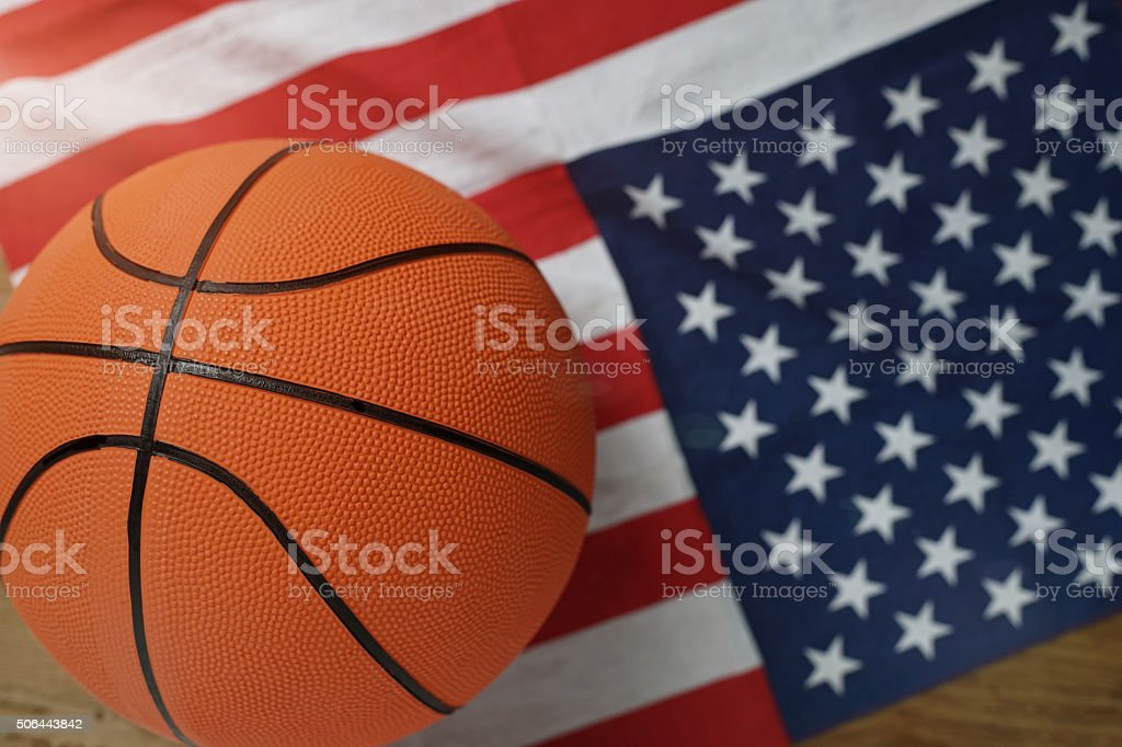 Basketball on American flag at the top view stock photo