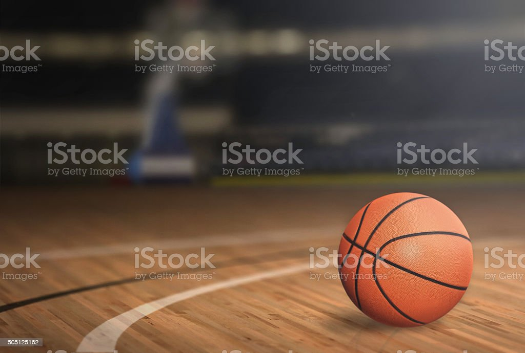 Basketball on Court Floor stock photo