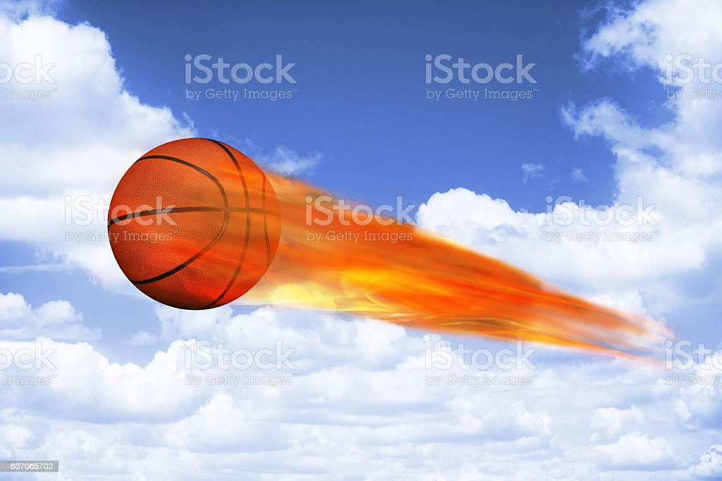 Basket ball on fire flying high in the sky.