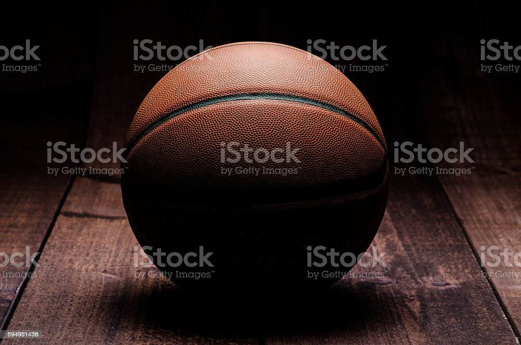 Basketball on hardwood stock photo