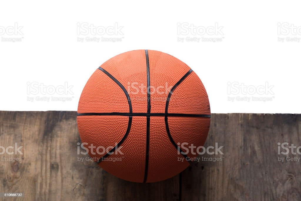 Basketball on old wood table and white background stock photo
