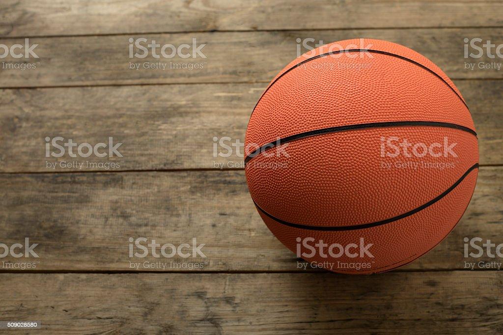 Basketball on old wood table stock photo