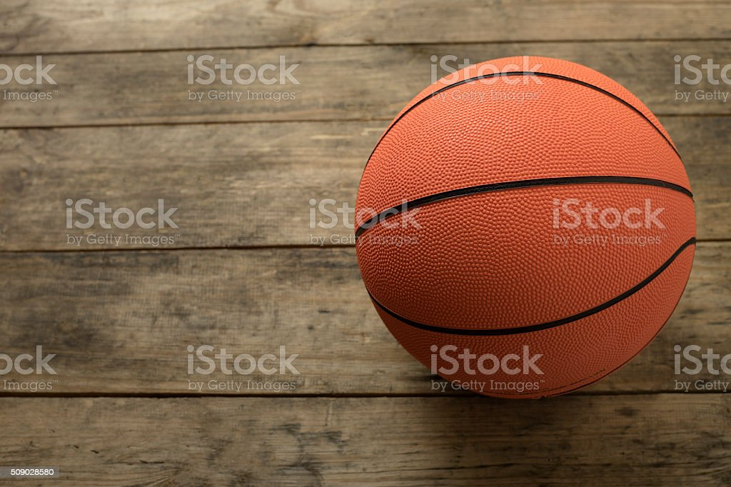 Basketball on old wood table stock photo
