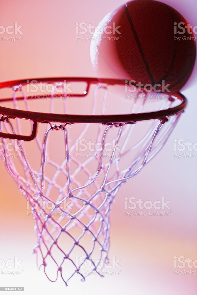 Basketball on rim of hoop royalty-free stock photo