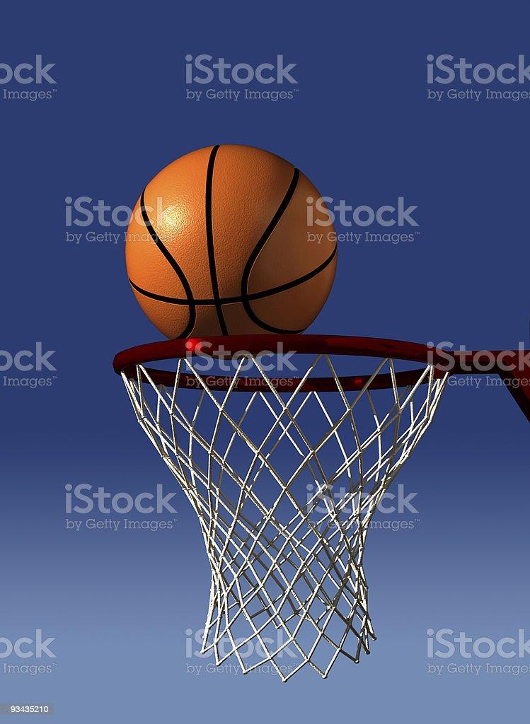 A basketball on the basketball hoop royalty-free stock photo