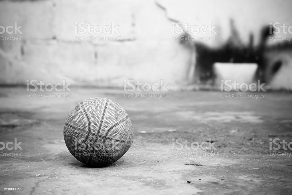 Basketball on the cement floor stock photo