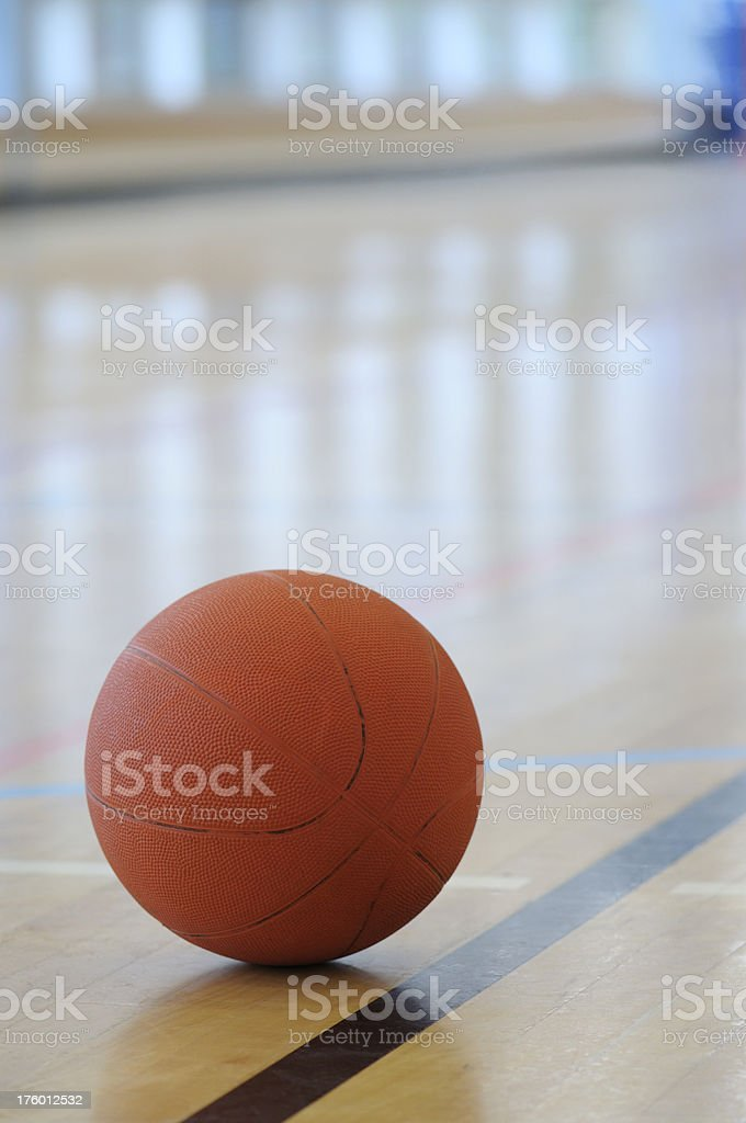 Basketball on the floor in a gym royalty-free stock photo