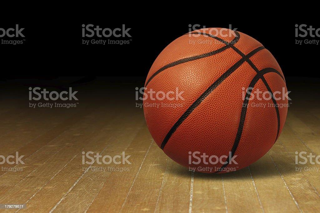 Basketball On Wood Court stock photo
