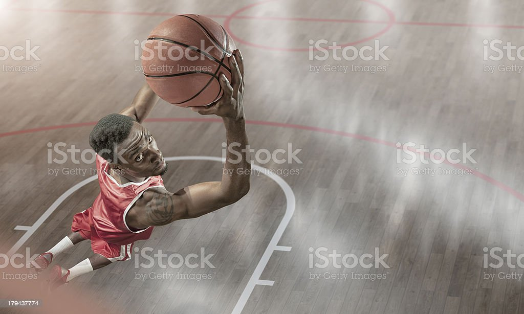 Basketball Player About to Reverse Dunk royalty-free stock photo