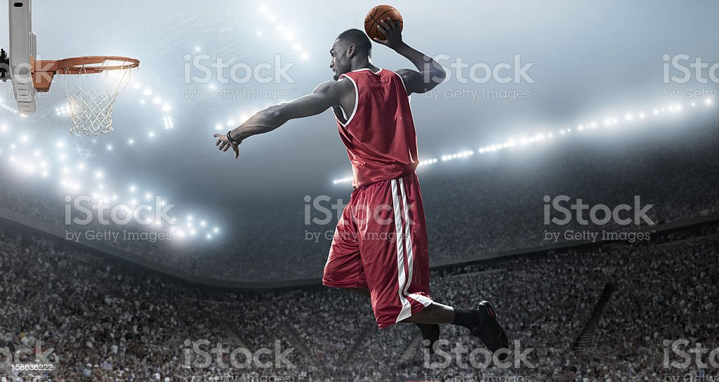 Basketball Player About To Slam Dunk stock photo