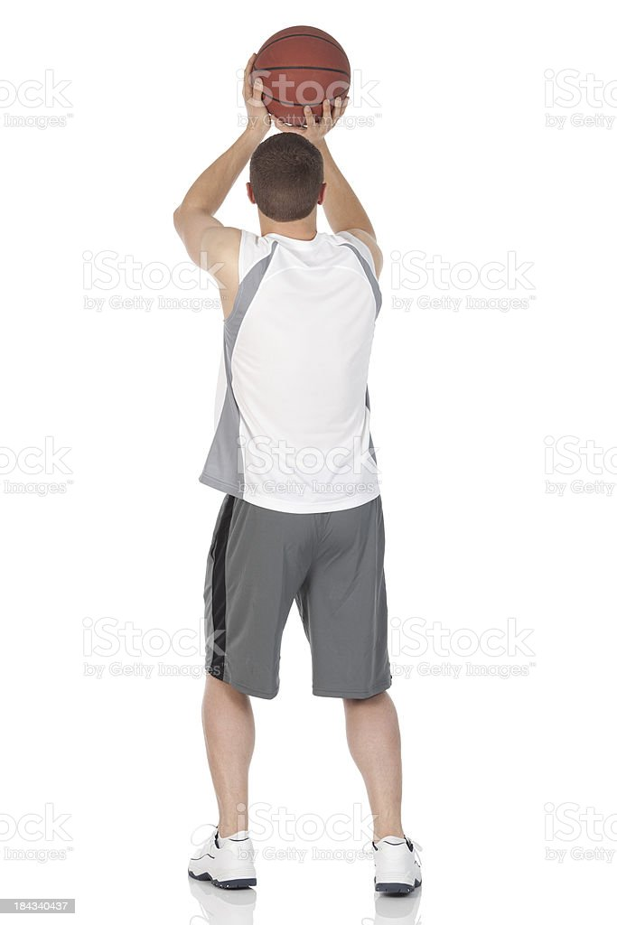 Basketball player about to throw the ball stock photo