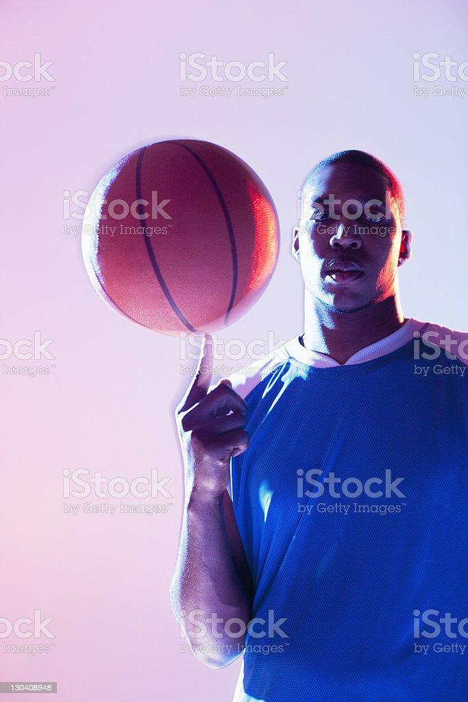 Basketball player balancing ball on one finger royalty-free stock photo