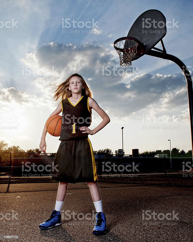 Basketball Player by Hoop stock photo