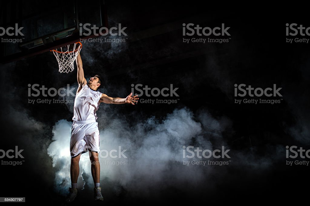 Basketball Player Dunking stock photo