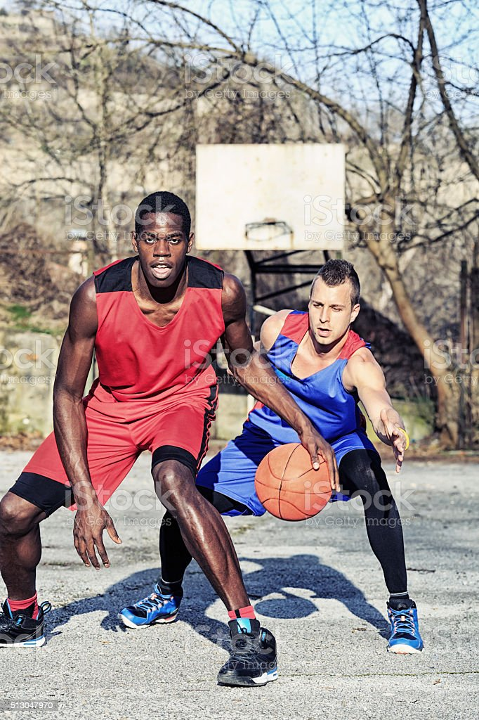 Basketball player failed to block the opponent with a ball stock photo