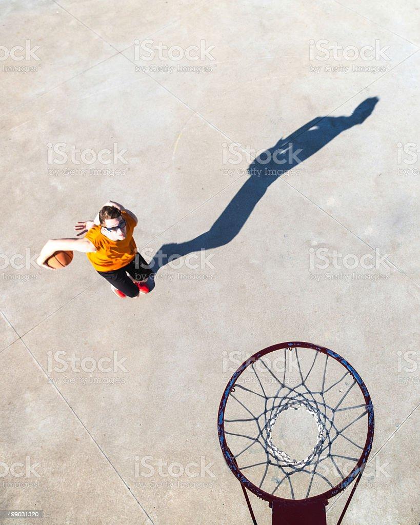 Basketball player goes toward the hoop stock photo
